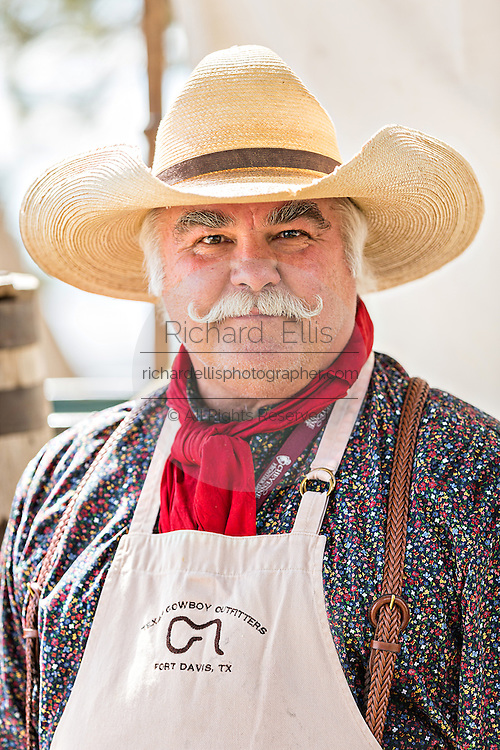 An old cowboy cook during a chuck wagon competition during Cheyenne Frontier Days July 25, 2015 in Cheyenne, Wyoming. Frontier Days celebrates the cowboy traditions of the west with a rodeo, parade and fair.