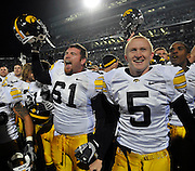 Oct 24, 2009; East Lansing, MI, USA; Iowa defensive tackle Travis Meade (61) and punter Ryan Donahue (5) celebrate with their teammates after they beat the Spartans 15-13 at Spartan Stadium. Mandatory Credit: Jason Miller-US PRESSWIRE