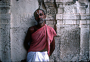 India. Priest at Mahabalipuram temple.<br />