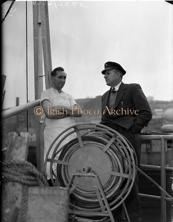20/03/1959<br /> 03/20/1959<br /> 20 March 1959<br /> Gael Linn Singing competition in Newry, Co. Down. Captain Michael Hegarty, Moville, Co. Donegal and Cook, Daniel Bonner, Colraine, Co. Derry, chatting onboard their ship the M.V. Silverthorn of Liverpool on the morning after their visit to the Gael-Linn concert and singing competition at Newry Town Hall on the night of the 19th March.