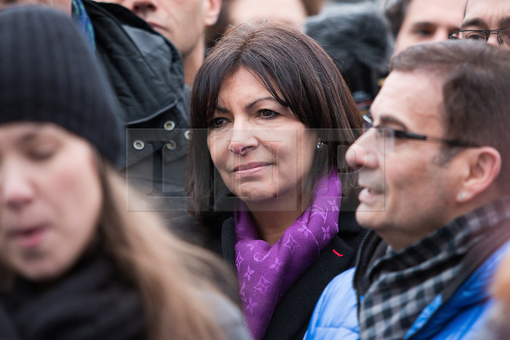 © Licensed to London News Pictures. 10/01/2016. France, Paris. The Paris Mayor Anne Hidalgo listens to a choir singing. French officials are joined by family members of the victims the 2015 Charlie Hebdo Shootings. Today January 10th 2016. Photo credit: Hugo Michiels/LNP