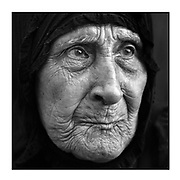 Faces of Mosul<br /> <br /> A collection of images from 4 time Pulitzer prize winning photographer Carol Guzy, gives us a glimpse into the faces of those affected by the fierce conflict with ISIS in Mosul. Wounded and weak, most who survived now face an uncertain future in the limbo of IDP camps. Shattered lives, lost loved ones and escape from the rubble of collapsed homes and the evil of ISIS doctrine, leaves scars of emotional trauma even more difficult to heal. The war in Mosul is over, but the humanitarian crisis continues.<br /> <br /> Mosul, Iraq - SELMA ABDULLA FETE, 87, anxiously awaits word on her son Flah Hasin who was pulled for questioning of men to be confirmed whether they are ISIS fighters or not. She rejoiced when he was released and they could leave on the truck to safety. Civilians, many injured and weak, flee continued battle with ISIS in West Mosul amid ruins of the city. They arrive at a Trauma Stabilization Point near the Old City for emergency medical care and transport.<br />  &copy;Carol Guzy/zReportage.com/Exclusivepix Media