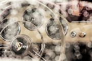 Image of a vintage Porsche 356 dashboard with raindrops at Luftgekuehlt 4, San Pedro, California, America west coast