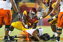 September 11, 2010; Los Angeles, CA, USA;  Southern California Trojans defensive tackle DaJohn Harris (98) sacks Virginia Cavaliers quarterback Marc Verica (6) during the third quarter at the Los Angeles Memorial Coliseum.  USC defeated Virginia 17-14.