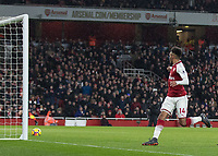 Football - 2017 / 2018 Premier League - Arsenal vs. Everton<br /> <br /> Pierre-Emerick Aubameyang (Arsenal FC) watches the ball roll over the goal line to mark his debut with a goal at The Emirates.<br /> <br /> COLORSPORT/DANIEL BEARHAM