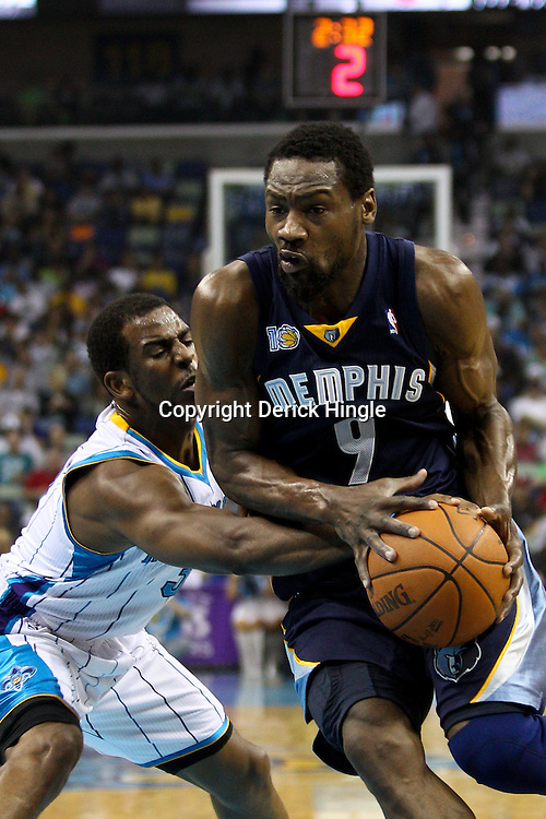 April 1, 2011; New Orleans, LA, USA; New Orleans Hornets point guard Chris Paul (3) knocks the ball away from Memphis Grizzlies shooting guard Tony Allen (9) during the first quarter at the New Orleans Arena.    Mandatory Credit: Derick E. Hingle