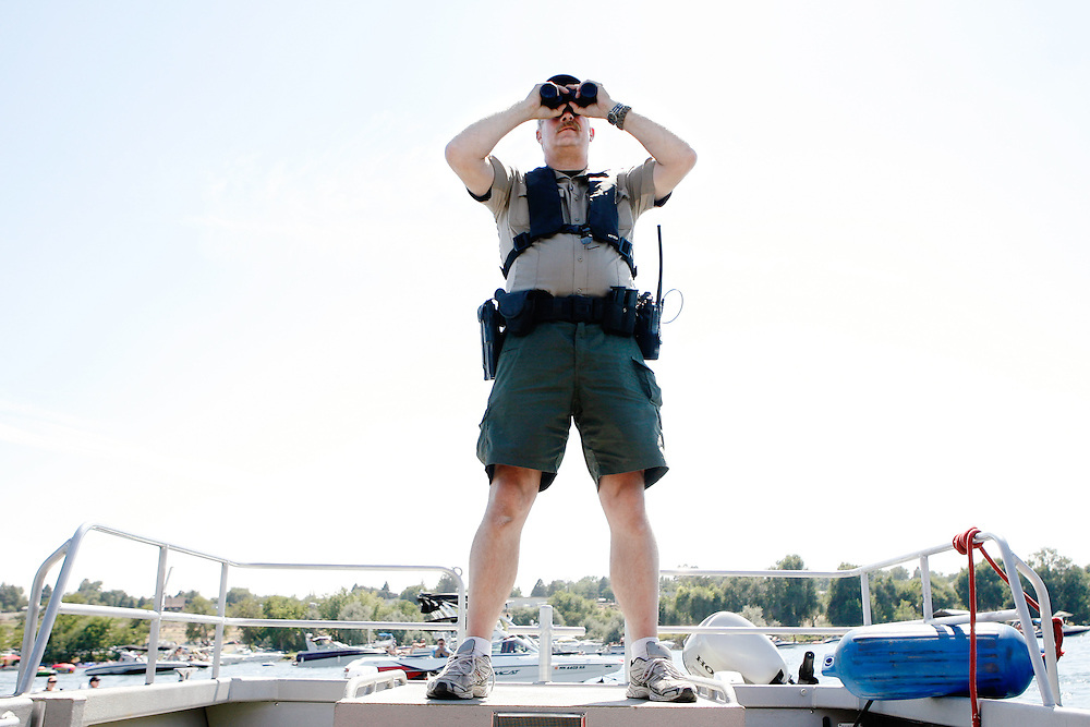 Benton County sheriff's Deputy Scott Belcher keeps an eye on boaters on Saturday, making sure people celebrated safely and lawfully. The sheriffs worked with the U.S. Coast Guard to make sure boaters stayed far enough away from the race course.