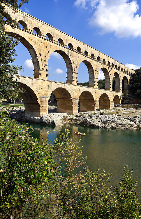 A family canoes down the Gardon River, with the Pont du Gard soon be be overhead.  Built by the Romans circa 19 B.C., this wonder of stone was a major link in a 30-mile canal that brought water to Nimes.  It is the world's second highest standing Roman structure.