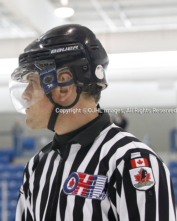 OAKVILLE, ON - Sep 28, 2014 :  Ontario Junior Hockey League game action between Wellington and Buffalo at the Governor's Showcase Tournament. OHA Linesman.<br /> (Photo by Tim Bates / OJHL Images)