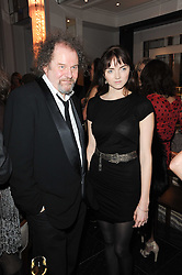 MIKE FIGGIS and LILY COLE at the Liberatum Dinner hosted by Ella Krasner and Pablo Ganguli in honour of Sir V S Naipaul at The Landau at The Langham, Portland Place, London on 23rd November 2010.