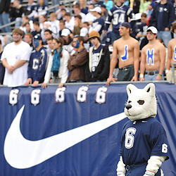 Oct 31, 2009; East Hartford, CT, USA; Connecticut mascott Jonathan the Huskie and fans watch pregame ceremonies in memory of slain Connecticut player Jasper Howard before first half Big East NCAA football action between Rutgers and Connecticut at Rentschler Field.
