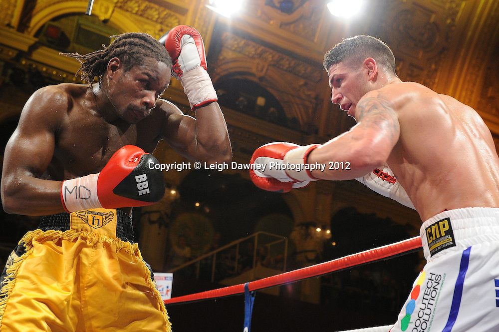 Brian Rose (white shorts) defeats Max Maxwell for the British Light Middleweight Champion at The Winter Gardens, Blackpool on the 31st March 2012. Frank Maloney and Steve Wood VIP Promotions. © Leigh Dawney Photography 2012.