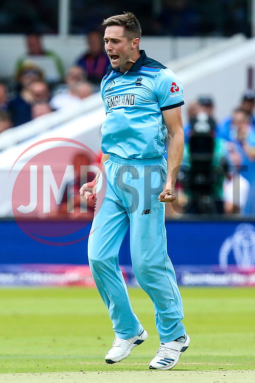 Chris Woakes of England  celebrates taking the wicket of Martin Guptill of New Zealand - Mandatory by-line: Robbie Stephenson/JMP - 14/07/2019 - CRICKET - Lords - London, England - England v New Zealand - ICC Cricket World Cup 2019 - Final