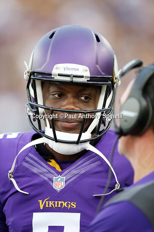 Minnesota Vikings quarterback Teddy Bridgewater (5) looks on from the sideline during the 2015 NFL Pro Football Hall of Fame preseason football game against the Pittsburgh Steelers on Sunday, Aug. 9, 2015 in Canton, Ohio. The Vikings won the game 14-3. (©Paul Anthony Spinelli)