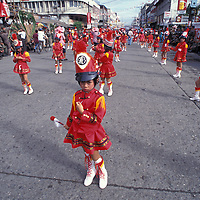 Philippines, Girls in marching band in Dinagyang Festival in Iloilo, on Panay Island.