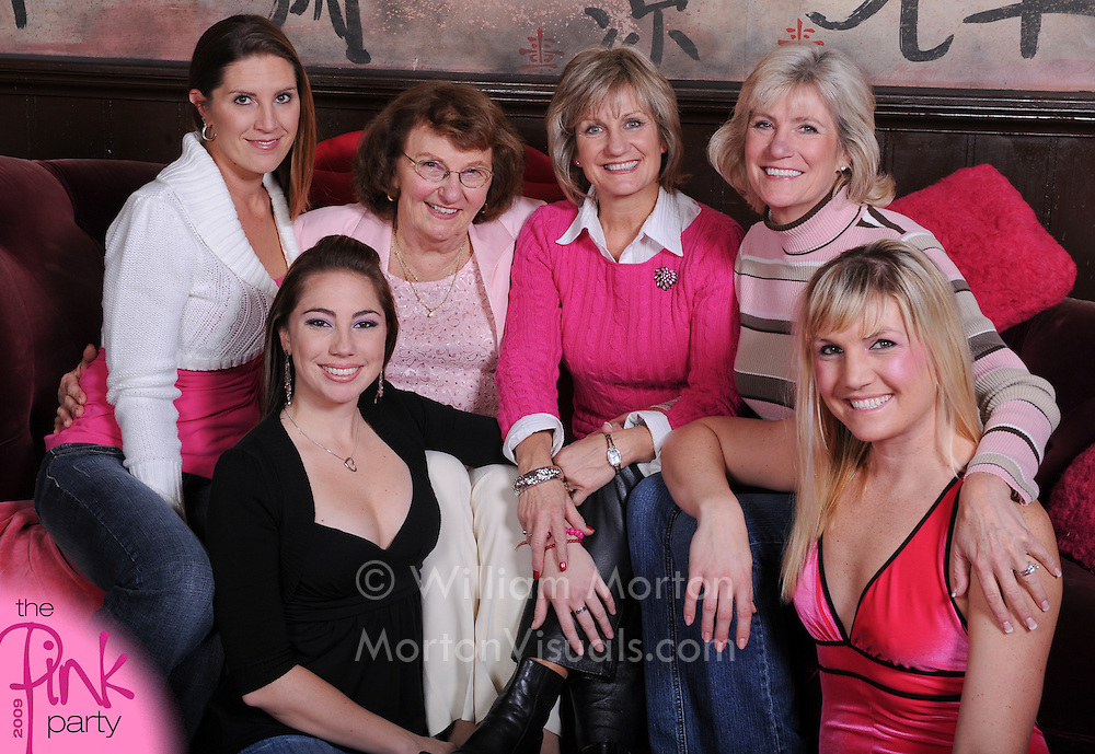 A group portrait during a breast cancer fundraiser at the House of Blues is photographed and printed on-the-spot by Dallas event photographer William Morton of Morton Visuals event photography.