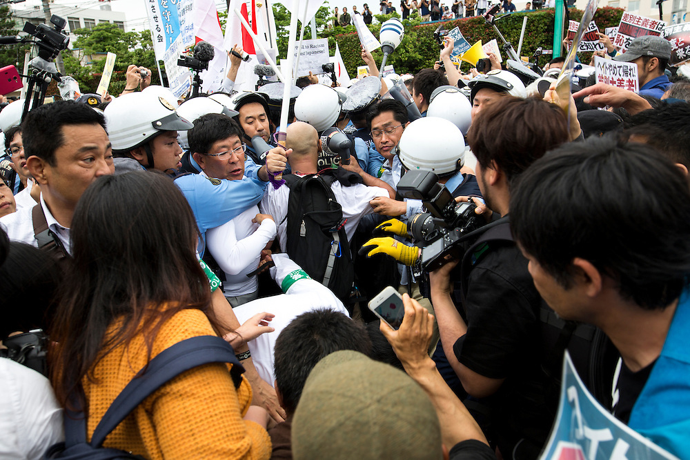 KAWASAKI, JAPAN - JUNE 05: Various fascist and racist groups clash with police as they try to disrupt an counter-racist protest in Nakahara Peace Park, Kawasaki City, Kanagawa prefecture, Japan on June 5, 2016. A district court in Kanagawa Prefecture has issued a first-ever provisional injunction preventing an anti-Korean activist from holding a rally near the premises of a group that supports ethnic Korean people.<br /> <br /> Photo: Richard Atrero de Guzman
