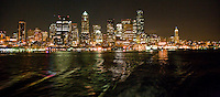 Seattle at night from a Washington State Ferry in Puget Sound, WA, USA
