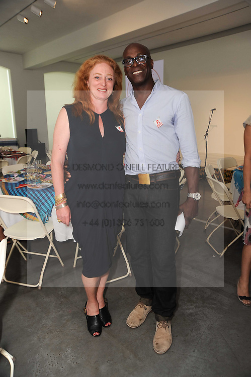 CAMILLA LOWTHER and CHARLES ADOAH at a charity lunch organised in aid of ASAP (African Solutions to African Problems) held at the Louise T Blouin Foundation, 3 Olaf Street, London W11 on 23rd June 2010.