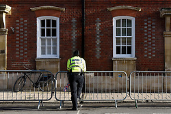 © Licensed to London News Pictures. 12/10/2018. WINDSOR, UK.  A police officer next to a railing in Windsor ahead of the royal wedding of Princess Eugenie and Jack Brooksbank.  Princess Eugenie, 28, the younger daughter of the queen's third child Prince Andrew and his ex-wife Sarah Ferguson, the Duchess of York, will marry Jack Brooksbank, a 32-year-old drinks executive, in Windsor Castle before taking part in a short carriage procession through Windsor town.  This is the second royal wedding in Windsor in 2018, Prince Harry married Meghan Markle in May.  Photo credit: Stephen Chung/LNP