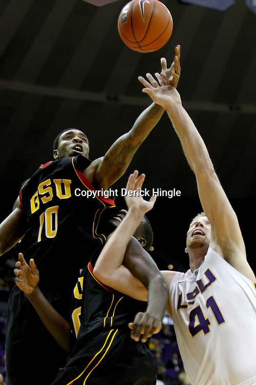 December 29, 2011; Baton Rouge, LA; Grambling State Tigers guard Quincy Roberts (10), center Peter Roberson (40) and LSU Tigers center Justin Hamilton (41) battle for a rebound during the first half of a game at the Pete Maravich Assembly Center.  Mandatory Credit: Derick E. Hingle-US PRESSWIRE