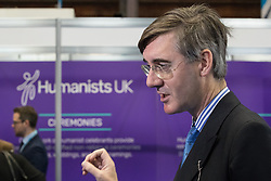 © Licensed to London News Pictures . 02/10/2017. Manchester, UK. JACOB REES-MOGG is interviewed for television at the conference in front of the Humanists UK stand . The second day of the Conservative Party Conference at the Manchester Central Convention Centre . Photo credit: Joel Goodman/LNP