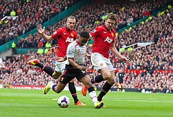 16.03.2014, Old Trafford, Manchester, ENG, Premier League, Manchester United vs FC Liverpool, 30. Runde, im Bild Liverpool's Raheem Sterling, action against Manchester United // during the English Premier League 30th round match between Manchester United and Liverpool FC at Old Trafford in Manchester, Great Britain on 2014/03/16. EXPA Pictures &copy; 2014, PhotoCredit: EXPA/ Propagandaphoto/ David Rawcliffe<br /> <br /> *****ATTENTION - OUT of ENG, GBR*****