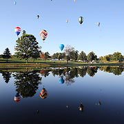 Hot Air balloons reflected in the lake at Hideaway Hills Family Campground in rural Michigan near Battle Creek during competition in the 20th FAI World Hot Air Ballooning Championships. Battle Creek, Michigan, USA. 22nd August 2012. Photo Tim Clayton