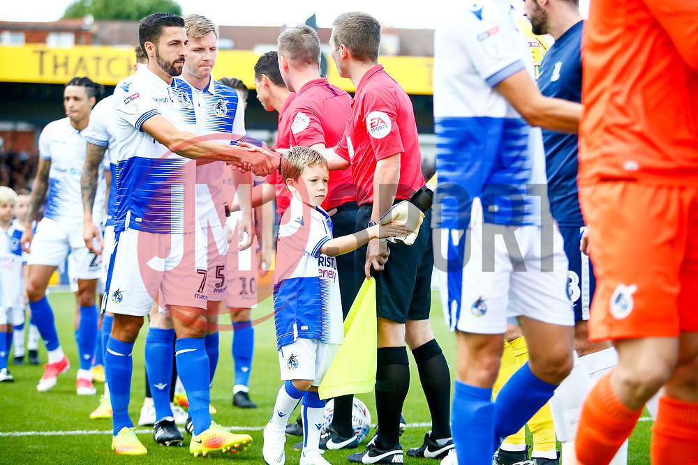 Child match mascots walk out with the team, pictured Liam Sercombe of Bristol Rovers with captain mascot - Mandatory by-line: Ryan Hiscott/JMP - 25/08/2018 - FOOTBALL - Memorial Stadium - Bristol, England - Bristol Rovers v Southend United - Sky Bet League One