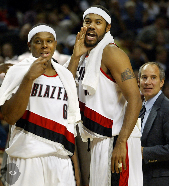 The Blazers' Bonzi Wells (6) and Rasheed Wallace (30) talk a little trash to a Rockets' player on the line for a  foul shot. The Blazers beat the Rockets in their first pre-season  game opener..