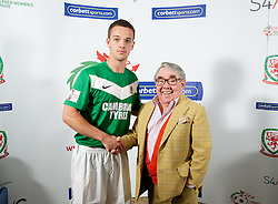 CARDIFF, WALES - Tuesday, August 14, 2012: Aberystwyth Town's Stuart Jones with Ronnie Corbett, the sporting ambassador ot Corbett Sport, at the launch the 2012/2013 Welsh Premier League at the St. David's Hotel. (Pic by David Rawcliffe/Propaganda)