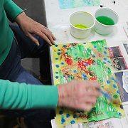 "Nancy Hawfield paints a quilt square during ""Create Your Own Quilt Squares"" Sunday November 23, 2014 at the Cameron Art Museum in Wilmington, N.C. (Jason A. Frizzelle)"