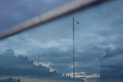 Relfections through a glass panel whowing the seaside town of Bridlington, including the town's Spa, on 13th July 2017, at Bridlington, East Riding, England.