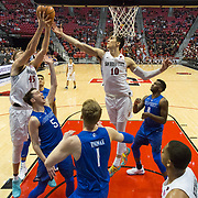 03 February 2018: The San Diego State Aztecs look to rebound after a couple losses against Air Force Saturday night. San Diego State Aztecs forward Max Montana (10) and center Kameron Rooks (45) battle for rebound in the second half. The Aztecs beat the Falcons 81-50 at Viejas Arena.<br /> More game action at www.sdsuaztecphotos.com