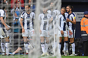 West Bromwich Albion forward Dwight Gayle (16), on loan from Newcastle United scores a goal 1-0 and celebrates during the EFL Sky Bet Championship match between West Bromwich Albion and Millwall at The Hawthorns, West Bromwich, England on 22 September 2018.