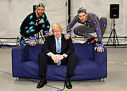 "© Licensed to London News Pictures. 04/04/2013. London, UK (Left to right) Actors Matt Cross, Boris Johnson. Boris Johnson the Mayor of London, visits Ealing studios today, 4th April 2013, where he announced his plans to boost London's TV, Animation and Film industries, capitalising on the new tax relief brought in by the Chancellor (from 1st April 2013) to bring major jobs and investment to the capital. He toured the Studios and spent time in the ""Imaginarium"", where he had a go at mastering 'performance capture'. . Photo credit : Stephen Simpson/LNP"