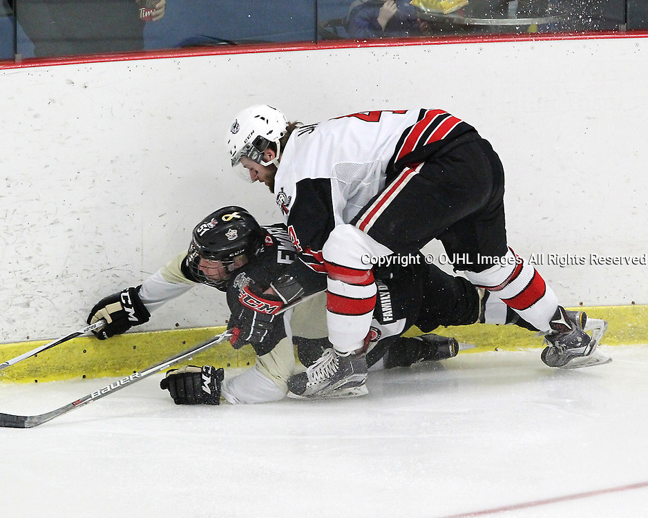 GEORGETOWN, ON  - APR 13,  2017: Ontario Junior Hockey League, Championship Series. Georgetown Raiders vs the Trenton Golden Hawks in Game 1 of the Buckland Cup Final. Max Ewart #51 of the Trenton Golden Hawks and Michael Vukojevic #44 of the Georgetown Raiders battle for the puck during the first period.<br /> (Photo by Tim Bates / OJHL Images)