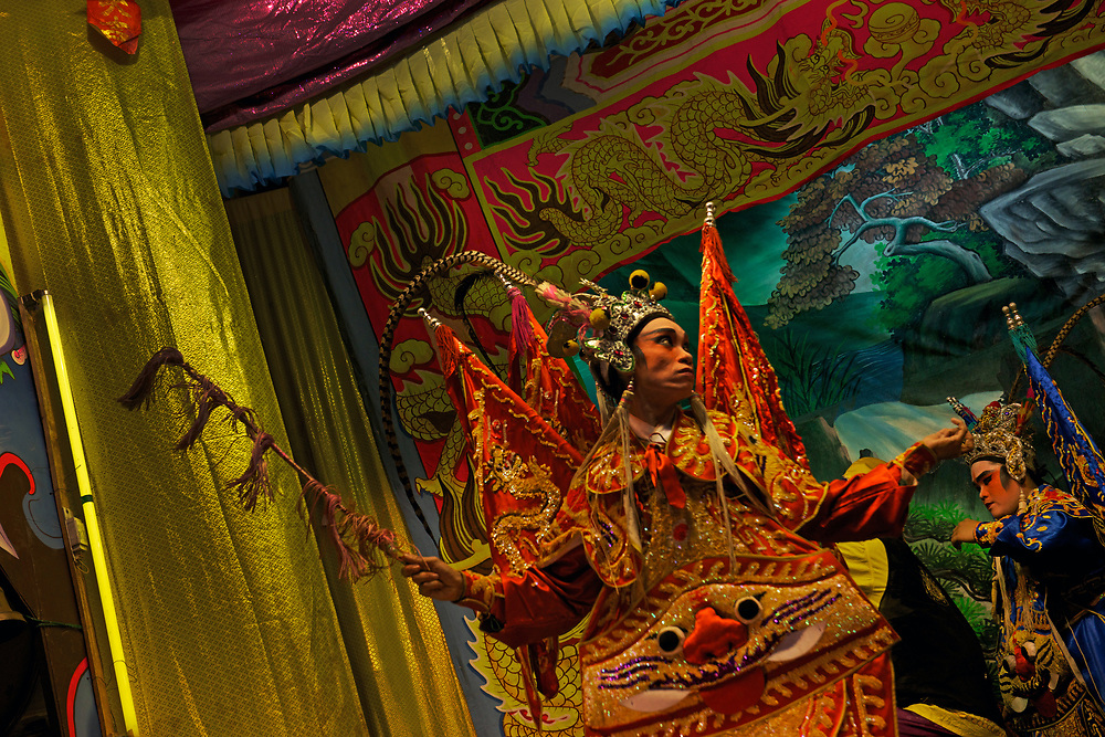 A travelling Chinese Opera troupe perform for Chinese New Year at Wat Phlapphla Chai, Chinatown, Bangkok. 31 January, 2014.