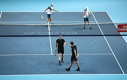 Bruno Soares (bottom righ) and Jamie Murray react during their doubles match against Mike and Bob Bryanduring day two of the NITTO ATP World Tour Finals at the O2 Arena, London.