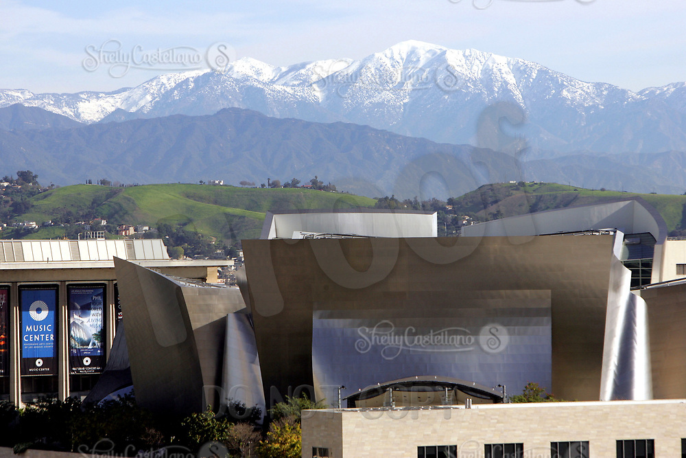 Jan 16, 2005; Los Angeles, CA, USA; Downtown Los Angeles city scape. View of Los Angeles Performing Arts Center and the Walt Disney Concert Hall on 1st and Hope Streets, designed by Frank Gehry with snow on the mountains behind in the background. Scenic view of downtown LA skyline from inside the city. <br />Mandatory Credit: Photo by Shelly Castellano/ZUMA Press.
