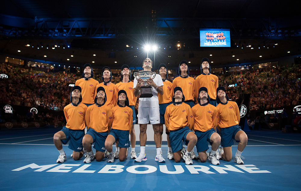 Roger Federer of Switzerland with ballkids after winning the 2018 Australian Open on day 14 at Rod Laver Arena in Melbourne, Australia on Sunday afternoon January 28, 2018.<br /> (Ben Solomon/Tennis Australia)