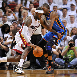 Jun 17, 2012; Miam, FL, USA; Miami Heat small forward LeBron James (6) is guarded by Oklahoma City Thunder small forward Kevin Durant (35) during the second quarter in game three in the 2012 NBA Finals at the American Airlines Arena. Mandatory Credit: Derick E. Hingle-US PRESSWIRE