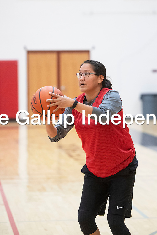 Leah Coan pulls up for a jump shot for Navajo Technical University (NTU), Saturday, Feb. 2 at NTU in Crownpoint during a staff and faculty basketball game between NTU and Diné College. Coan was the game's highest scorer with 18 points.