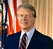 James Earl 'Jimmy' Carter, Jr. (born  1924) 39th President of the United States from 1977 to 1981.   Governor of Georgia 1971-1975. Head-and-shoulders portrait with stars-and-stripes in background. American Politician Democrat