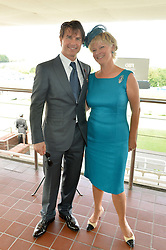 TOM CRUISE and the COUNTESS OF MARCH at the 2014 Glorious Goodwood Racing Festival at Goodwood racecourse, West Sussex on 31st July 2014.