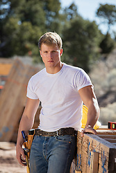 hunky construction worker outdoors on a job site