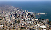 SHOT 10/8/11 10:08:46 AM - An aerial view of downtown Chicago, Illinois and Lake Michigan. Chicago is the largest city in the state of Illinois, the largest in the Midwest and, with a population of nearly 3 million people, is the third largest in the United States. Chicago is a city rich in history and also renowned for its architecture. Chicago attracts about 33 million visitors annually from around the world and nation. Upscale shopping along the Magnificent Mile, thousands of restaurants, as well as Chicago's eminent architecture, continue to draw tourists every year. (Photo by Marc Piscotty / © 2011)