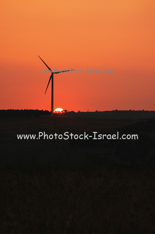 A Electric Generator, Wind turbine, between Buccheri and Palazzolo on the Iblei mountains, province of Siracusa, Sicily, Italy, at sun set July 2006