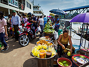 20 NOVEMBER 2017 - YANGON, MYANMAR: Vendors line the pier in Dala. Tens of thousands of commuters ride the ferry every day. It brings workers into Yangon from Dala, a working class community across the river from Yangon. A bridge is being built across the river, downstream from the ferry to make it easier for commuters to get into the city.     PHOTO BY JACK KURTZ
