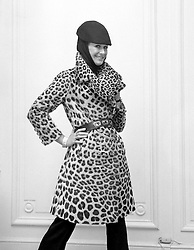 Aldine Honey wears a leopard trench coat priced at £5,000 and part of the House of Worth's Million Pound Fur Export Drive to Europe, shown at Grosvenor Street, London.